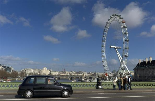 A bagpiper busks on Westminster Bridge in London March 8, 2012.