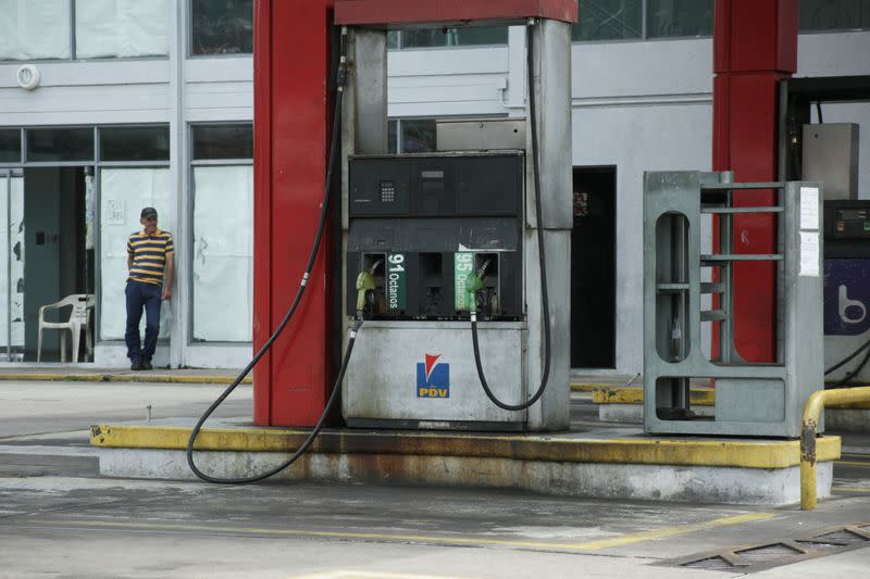 FILE PHOTO: A worker stands at a closed gas station of the state oil company PDVSA in San Cristobal