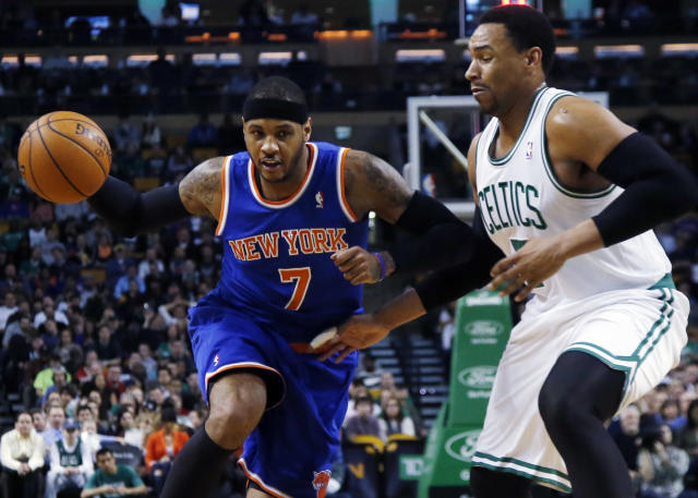 New York Knicks forward Carmelo Anthony, left, drives against Boston Celtics center Jared Sullinger, right, during the first quarter of an NBA basketball game in Boston, Wednesday, March 12, 2014. (AP Photo/Elise Amendola)