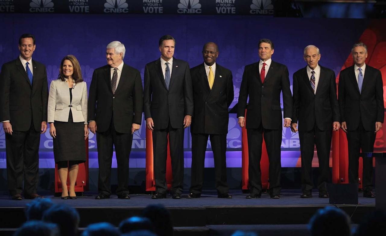 ROCHESTER, MI - NOVEMBER 09:  Republican presidential candidates (L to R) former U.S. Senator from Pennsylvania Rick Santorum, U.S. Representative Michele Bachmann (R-MN), former Speaker of the House Newt Gingrich, former Massachusetts Governor Mitt Romney, businessman Herman Cain, Texas Governor Rick Perry,  U.S. Representative Ron Paul (R-TX), and former Utah Governor Jon Huntsman, are introduced at a debate hosted by CNBC and the Michigan Republican Party at Oakland University on November 9, 2011 in Rochester, Michigan. The debate is the first meeting of the eight GOP presidential hopefuls since allegations of sexual impropriety have surfaced against front-runner Herman Cain.  (Photo by Scott Olson/Getty Images)