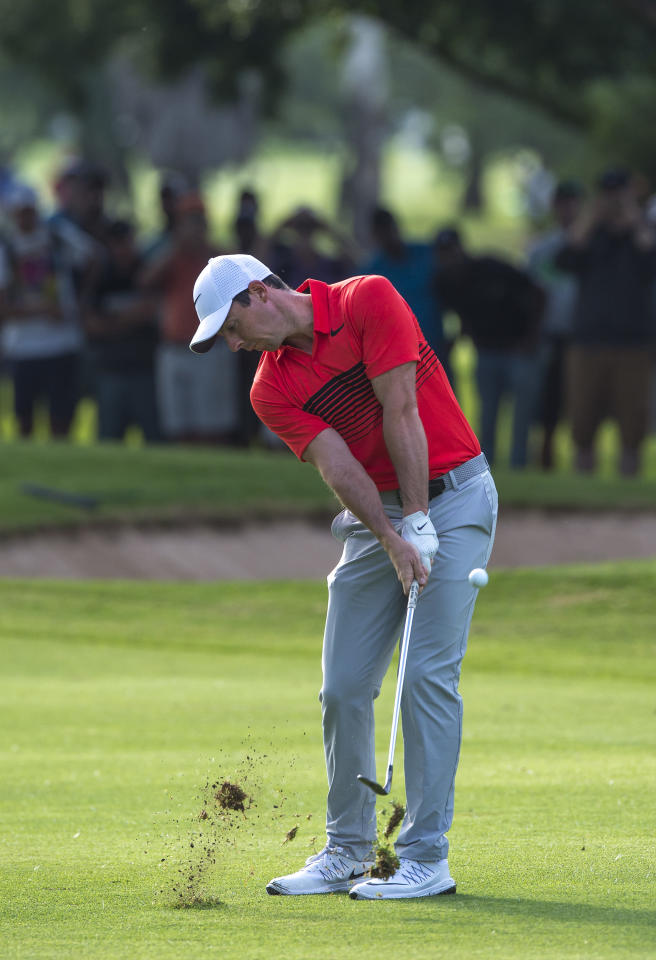 Rory McIlroy of Northern Ireland plays his approach shot on the 11th during the BMW South African Open at Glendower Golf Club on January 12, 2017 in Johannesburg. (AFP Photo/CHRISTIAAN KOTZE)