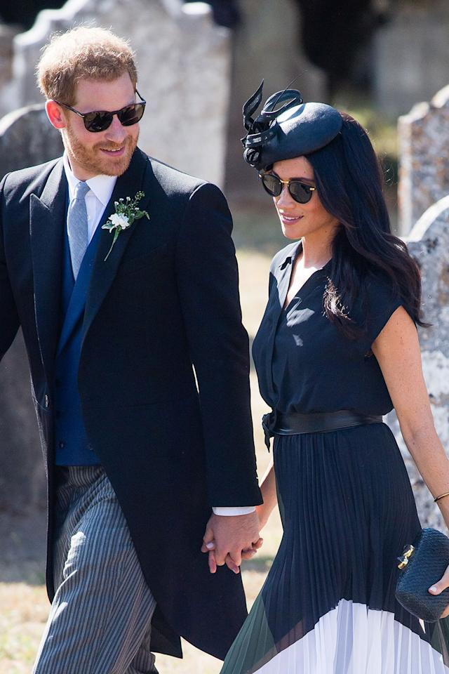 <p>On Meghan's 37th birthday in early August, she and Harry attended the wedding of Charlie van Straubenzee and Daisy Jenks. While we didn't spot it at the time, is there the smallest hint of curvature to her stomach here? Maybe we're just staring at it too hard...</p>