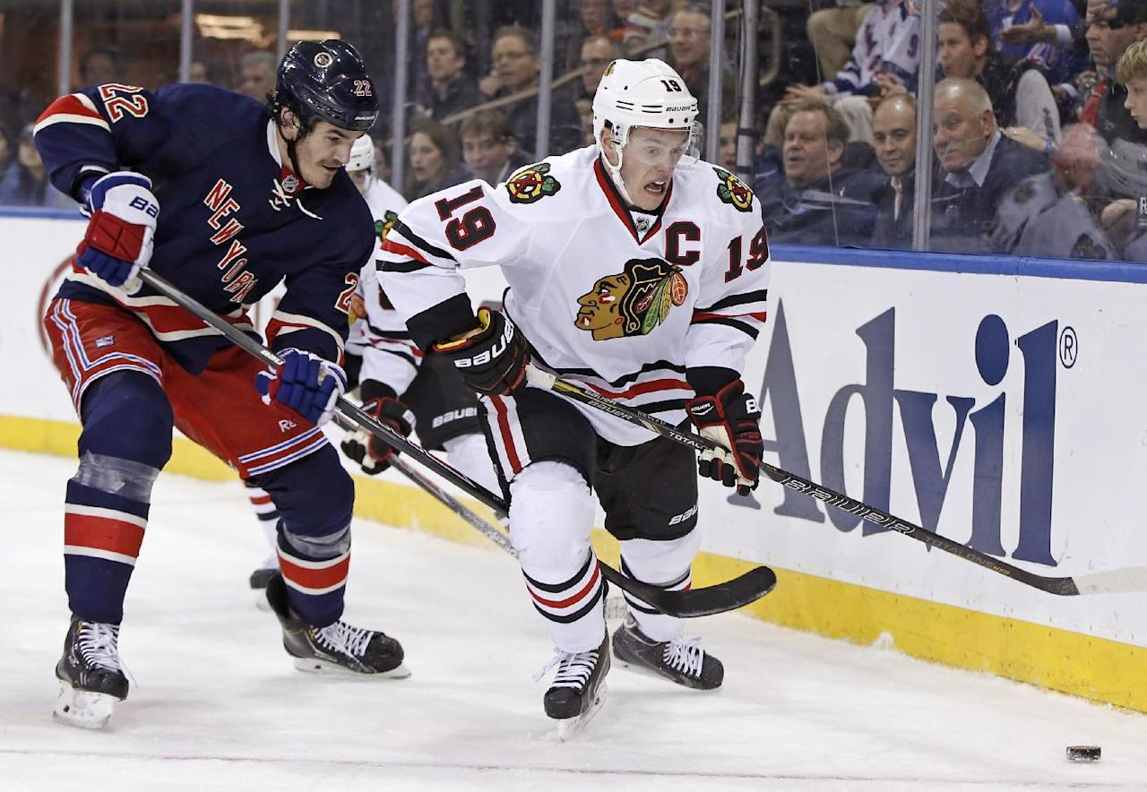New York Rangers center Brian Boyle (22) defends Chicago Blackhawks center Jonathan Toews (19) during the third period of an NHL hockey game at Madison Square Garden in New York, Thursday, Feb. 27, 2014. The Rangers defeated the Blackhawks 2-1. (AP Photo/Kathy Willens)
