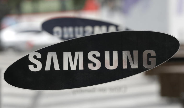 Samsung Electronics Co. logo is seen at a showroom of its headquarters in Seoul, South Korea, Friday, July 5, 2013. Even after setting a record high profit, Samsung Electronics disappointed investors who increasingly doubt its mainstay smartphone business can maintain rapid growth. Samsung Electronics Co. on Friday estimated its April-June operating profit at a record high of 9.5 trillion won ($8.3 billion). But it fell short of forecasts by analysts who held higher expectation for the world's largest smartphone maker. (AP Photo/Lee Jin-man)