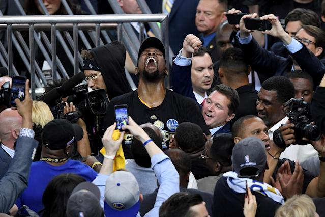 <p>Kevin Durant #35 of the Golden State Warriors celebrates after defeating the Cleveland Cavaliers 129-120 in Game 5 to win the 2017 NBA Finals at ORACLE Arena on June 12, 2017 in Oakland, California. </p>