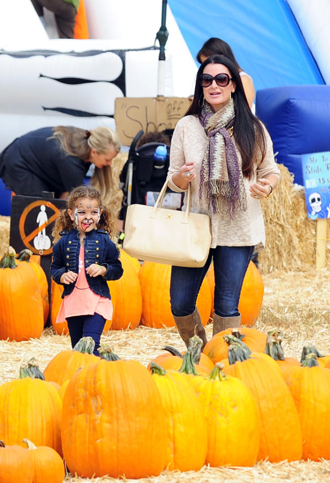 """Real Housewives of Beverly Hills"" star Kyle Richards brought her youngest daughter Portia to kick around the patch. (10/9/2012)<br><div style=""display:none;"" class=""skype_pnh_menu_container""><div class=""skype_pnh_menu_click2call""><a class=""skype_pnh_menu_click2call_action"">Call</a></div><div class=""skype_pnh_menu_click2sms""><a class=""skype_pnh_menu_click2sms_action"">Send SMS</a></div><div class=""skype_pnh_menu_add2skype""><a class=""skype_pnh_menu_add2skype_text"">Add to Skype</a></div><div class=""skype_pnh_menu_toll_info""><span class=""skype_pnh_menu_toll_callcredit"">You'll need Skype Credit</span><span class=""skype_pnh_menu_toll_free"">Free via Skype</span></div></div>"