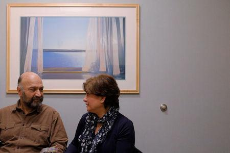 Patient Maziar Hashemi, who has the cancer Myelodysplastic syndrome, and his wife Fereshteh talk after meeting with his transplant doctor in Boston