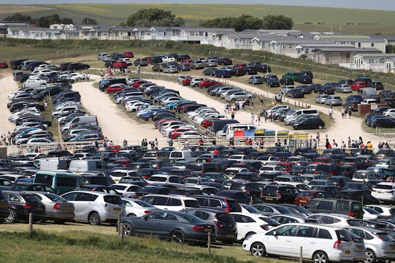 The car park was rammed at Durdle Door, near Lulworth in Dorset, as beachgoers flocked to the Jurassic Coast (PA)