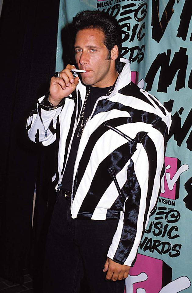 """<b>VMA Moment #5: The """"Dice"""" Gets Banned From MTV ... Forever (1989)</b>   There is a good chance that you're too young to remember the days when the MTV VMAs were hosted by Arsenio Hall and artists like Paula Abdul were scooping up Moonmen. But in 1989, raunchy comedian Andrew Dice Clay chose this particular ceremony to test-run a few of his """"Adult Nursery Rhymes."""" Let's just say it didn't go over so well. Jeff Kravitz/<a href=""""http://filmmagic.com/"""" target=""""new"""">FilmMagic.com</a> - September, 1989"""