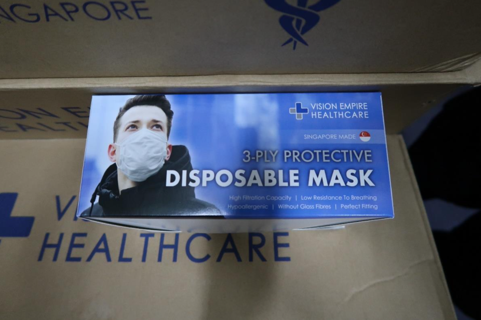 Face masks by Vision Empire International and branded under Vision Empire Healthcare were observed to be manufactured in an unhygienic and makeshift environment. The company is also suspected of importing surgical masks from overseas for repackaging and rebranding without a licence. (PHOTO: HSA)