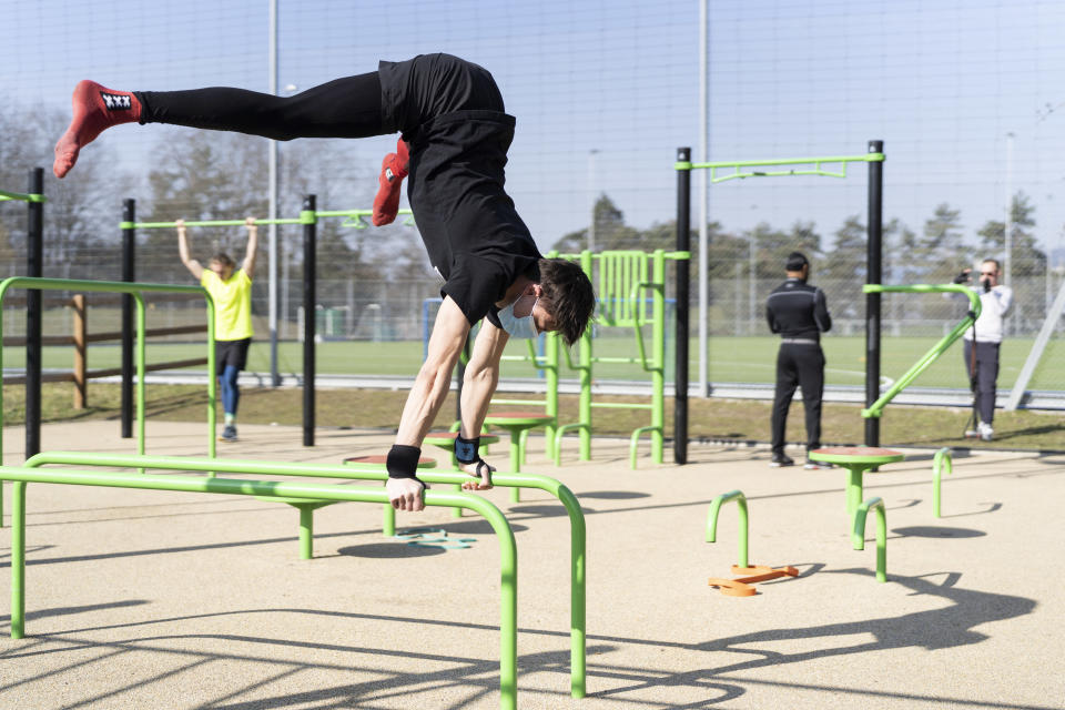 FILE - Athletes work out at a Zuerifit outdoor training facility in Zuerich, Switzerland, in this Monday, March 1, 2021, file photo. During the pandemic, people around the world sought relief from lock downs and working from home in leisure sports. (Gaetan Bally/Keystone via AP, File)