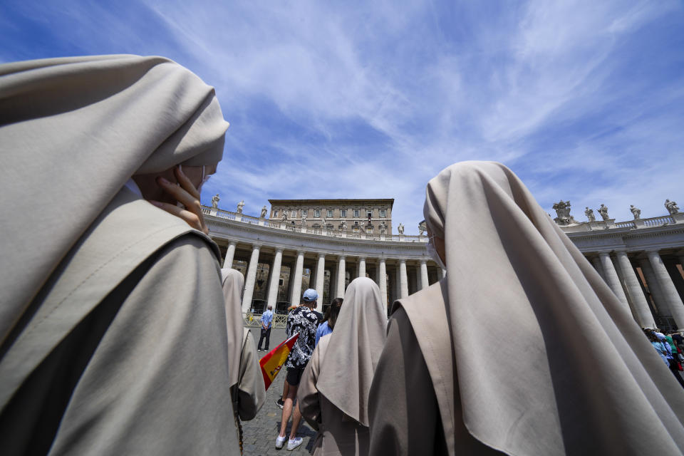 Nuns look at Pope Francis, top right, as he recites the Angelus noon prayer from the window of his studio overlooking St.Peter's Square, at the Vatican, Sunday, June 13, 2021. Francis demanded during his speech for humanitarian aid to reach residents of the war-torn Tigray region of northern Ethiopia, where Ethiopian and Eritrean soldiers are blocking food and other assistance. (AP Photo/Andrew Medichini)