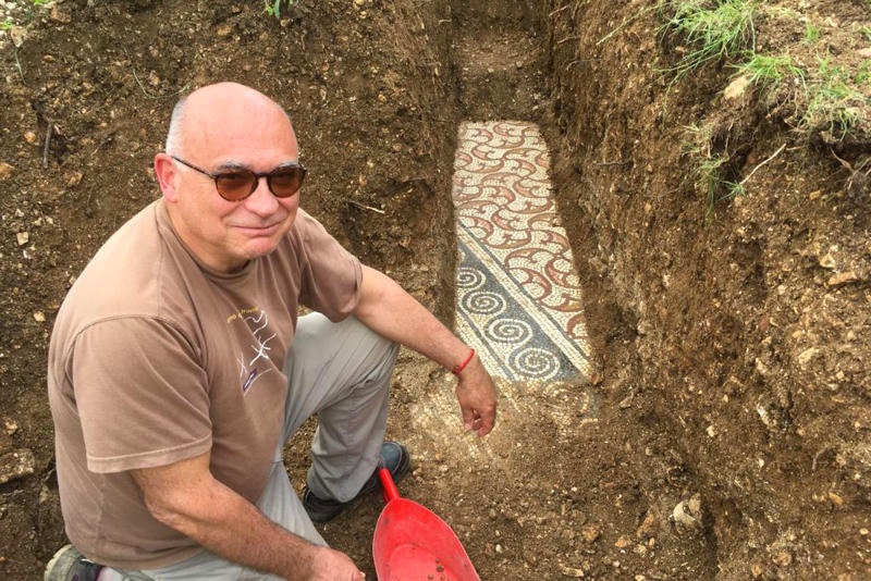 Gianni De Zuccato a well-preserved colorful mosaic floor of an ancient Roman villa archaeologists have revealed among vineyards near the northern city of Verona, Italy. The official in charge of archaeology Verona province, Gianni De Zuccato, on Friday, May 29,2020, said the mosaics appeared to be ''in a good state of conservation,'' from what they are able to observe after gingerly digging a trench between vineyards in the hills of Valpolicella, known for its full-bodied red wine. (Soprintendenza ABAP Verona via AP)