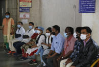 "FILE - In this Friday, Jan. 8, 2021 file photo, volunteers wait to participate in a trial run for the COVID-19 vaccine delivery system in Ahmedabad, India. Health officials around the world are racing to vaccinate enough people to stop the spread of the coronavirus -- but what qualifies as ""enough"" is still an open question. (AP Photo/Ajit Solanki)"