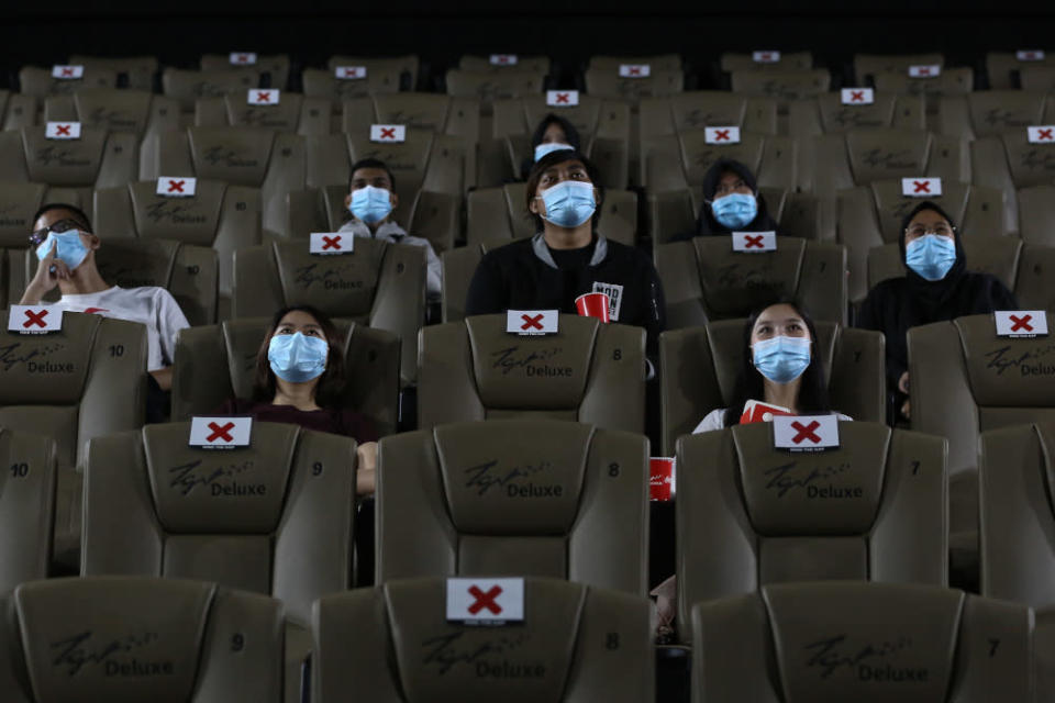 People wearing protective face masks sit while social distancing before watching a movie at a TGV cinema in Central I-City, Shah Alam July 1, 2020. — Picture by Yusof Mat Isa