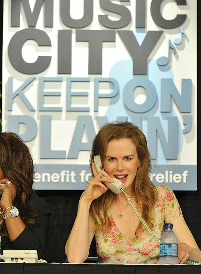 "Nicole Kidman, her country music star hubby Keith Urban, Sheryl Crow, and many more manned the phones and performed live for the Music City Keep on Playin' benefit in Nashville Sunday night. The event was held to aid victims of the devastating floods in Tennessee, and by 11:45 p.m. the telethon had raised over $1.7 million. Frederick Breedon/<a href=""http://www.gettyimages.com/"" target=""new"">GettyImages.com</a> - May 16, 2010"