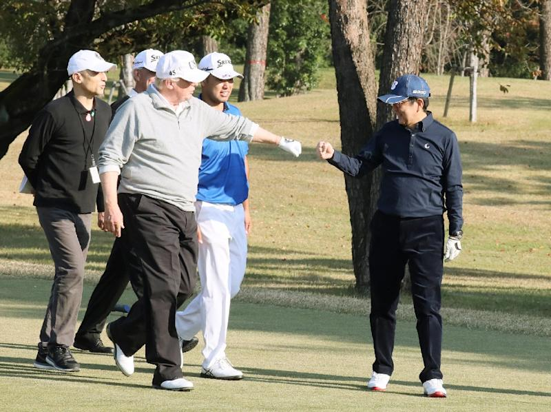 The two golf-mad leaders traded fist-bumps on the course (AFP Photo/Handout)