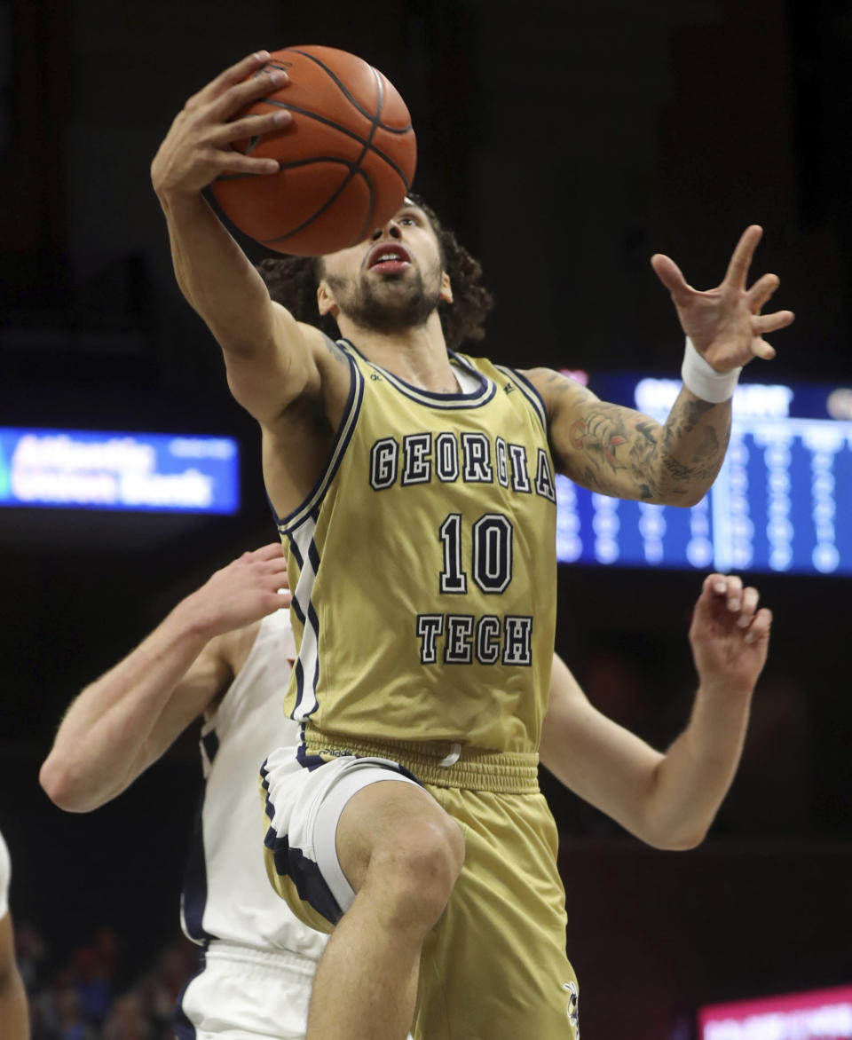 Georgia Tech guard Jose Alvarado (10) shoots in front of Virginia guard Casey Morsell (13) during an NCAA college basketball game Saturday, Jan. 23, 2021, in Charlottesville, Va. (Andrew Shurtleff/The Daily Progress via AP, Pool)