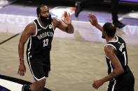 Brooklyn Nets guard James Harden celebrates with forward Kevin Durant (7) during the second half of an NBA basketball game against the Milwaukee Bucks, Monday, Jan. 18, 2021, in New York. (AP Photo/Adam Hunger)