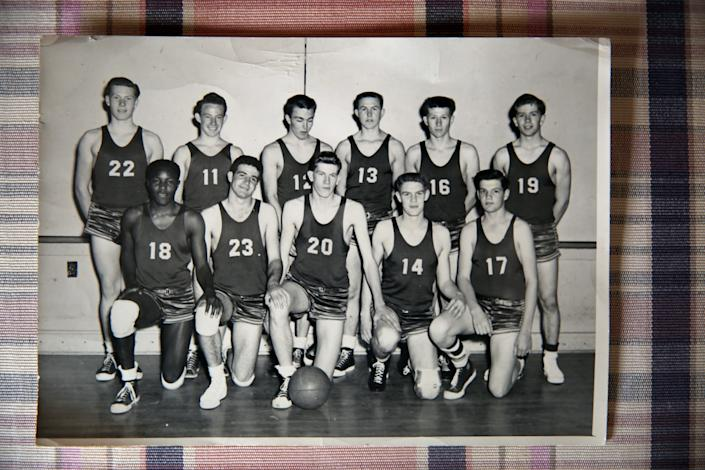 Basketball was one of four sports Rafer Johnson (18) lettered in in high school.