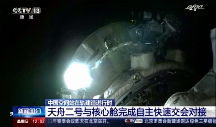 This image made from video footage by China's CCTV shows Tianhe core module's camera footage showing Tianzhou 2 cargo spacecraft approaching on Sunday, May 30, 2021. An automated spacecraft docked with China's new space station Sunday carrying fuel and supplies for its future crew, the Chinese space agency announced. (CCTV via AP Video)