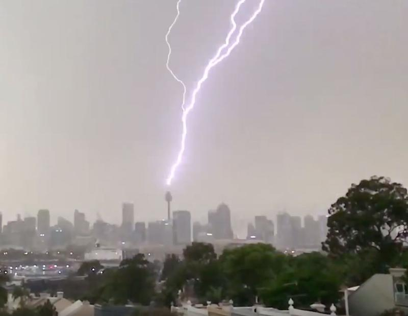 Westfield Tower in Sydney was struck by a lightning bolt as thunderstorm hits the city on Friday.
