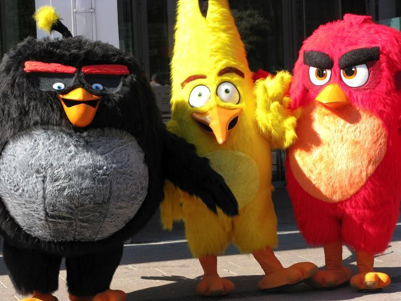 Angry Birds characters Bomb, Chuck and Red are pictured during the premiere in Helsinki