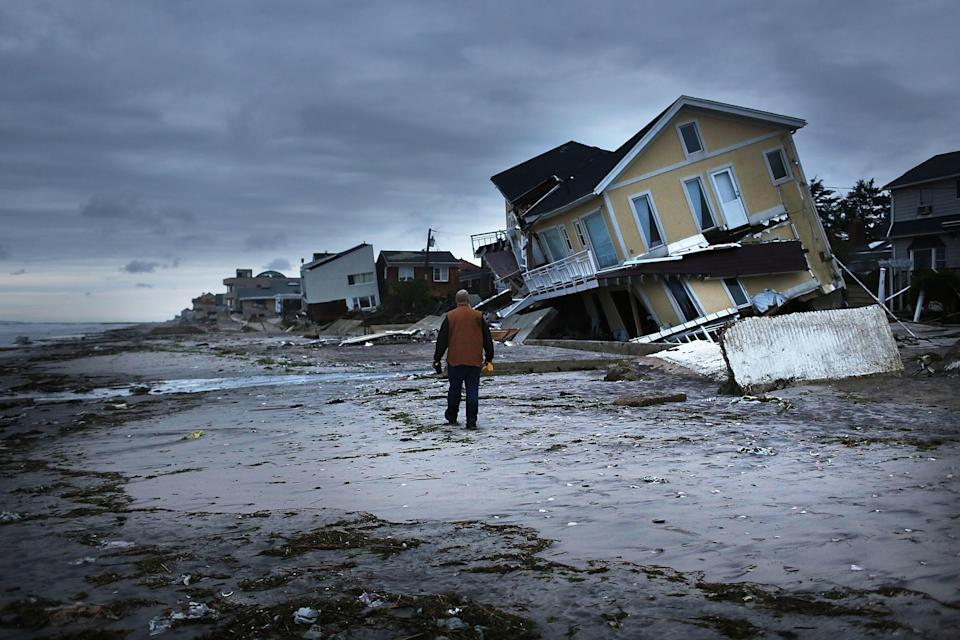 Damage is seen the Rockaway neighborhood of Queens, in New York City, where the historic boardwalk was washed away during Hurricane Sandy on October 31, 2012. / Credit: Spencer Platt/Getty Images