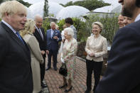 Britain's Queen Elizabeth II speaks to U.S. President Joe Biden and his wife Jill Biden during reception with the G7 leaders at the Eden Project in Cornwall, England, Friday June 11, 2021, during the G7 summit. (Jack Hill/Pool via AP)
