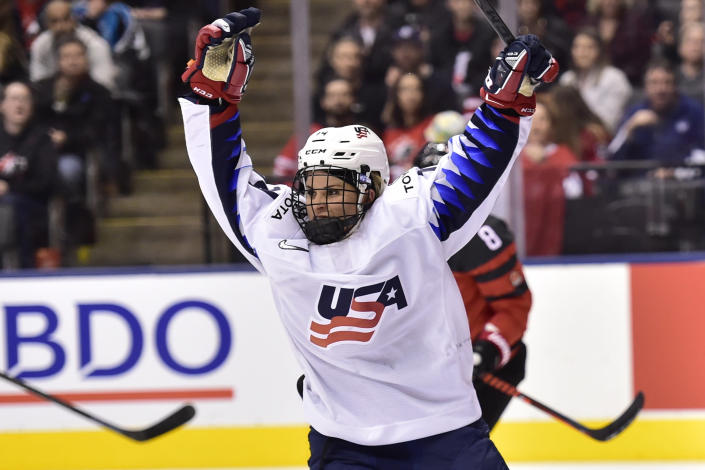 FILE - U.S. forward Brianna Decker (14) celebrates scoriung against Canada during the third period of a Rivalry Series hockey game in Toronto, in this Thursday, Feb. 14, 2019, file photo. Decker will enjoy a home-coming of sorts this weekend when the Professional Women's Hockey Players' Association holds its next Dream Gap Tour stop in Chicago. Decker grew up a Blackhawks fan and is looking forward to the opportunity to playing in Chicago's United Center where she watched numerous games. (Frank Gunn/The Canadian Press via AP, File)