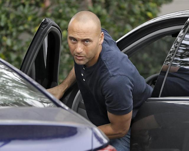 New York Yankees shortstop Derek Jeter arrives for a workout at the Yankees' minor league facility Wednesday, Feb. 12, 2014, in Tampa, Fla. Jeter says he will retire after this season. Jeter posted a long letter on his Facebook account Wednesday saying the 2014 will be his last year playing professional baseball. (AP Photo/Chris O'Meara)