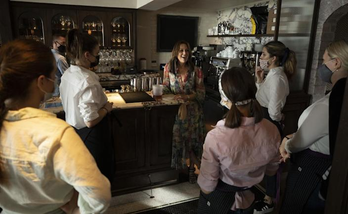 Dana Slatkin holds a pre-shift meeting with staff at Violet.
