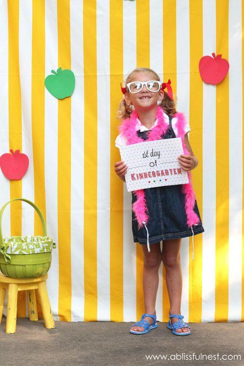 """<p>Make back-to-school season a party by unfurling a few yards of bright fabric and having kids pose in front of it (silly faces and outfits encouraged).</p><p><em>See more at <a href=""""http://ablissfulnest.com/2013/08/1st-day-of-school-photo-ideas.html"""" rel=""""nofollow noopener"""" target=""""_blank"""" data-ylk=""""slk:A Blissful Nest"""" class=""""link rapid-noclick-resp"""">A Blissful Nest</a> and <a href=""""http://www.livinglocurto.com/2013/08/school-photo-free-printable/#sthash.BsFVAmei.cH7HbmJl.dpbs"""" rel=""""nofollow noopener"""" target=""""_blank"""" data-ylk=""""slk:Living Lucurto"""" class=""""link rapid-noclick-resp"""">Living Lucurto</a> »</em> </p>"""