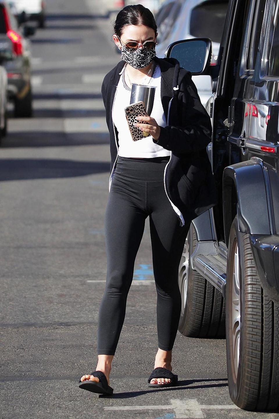 <p>Lucy Hale's leopard phone case jazzes up her all-business workout attire on the way to the gym in L.A.</p>