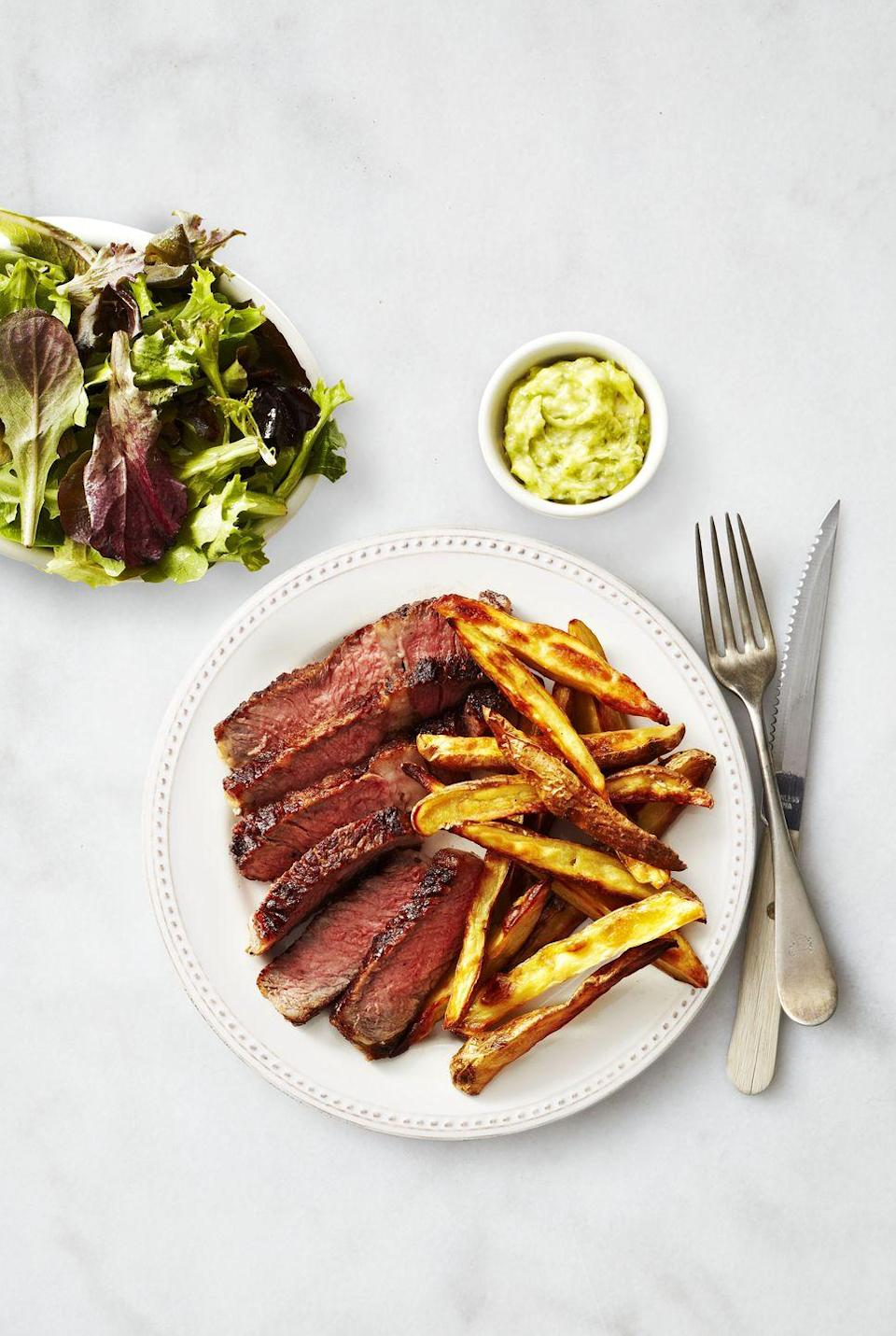 """<p>Steak and potatoes are a classic combo, but we love to dress up our favorites every once in a while. Pesto and butter come together to make a steak dressing you can't resist.</p><p><em><a href=""""https://www.goodhousekeeping.com/food-recipes/a37300/steak-and-fingerling-frites-recipe/"""" rel=""""nofollow noopener"""" target=""""_blank"""" data-ylk=""""slk:Get the recipe fro Steak and Fingerling Frites »"""" class=""""link rapid-noclick-resp"""">Get the recipe fro Steak and Fingerling Frites »</a></em></p><p><strong>RELATED</strong>: <a href=""""https://www.goodhousekeeping.com/food-recipes/g2346/steak-recipes/"""" rel=""""nofollow noopener"""" target=""""_blank"""" data-ylk=""""slk:25+ Simple Steak Recipes for Any Occassion"""" class=""""link rapid-noclick-resp"""">25+ Simple Steak Recipes for Any Occassion</a></p>"""