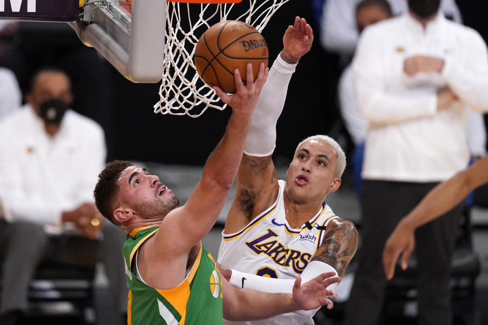 Utah Jazz forward Georges Niang, left, shoots as Los Angeles Lakers forward Kyle Kuzma defends during the first half of an NBA basketball game Saturday, April 17, 2021, in Los Angeles. (AP Photo/Mark J. Terrill)