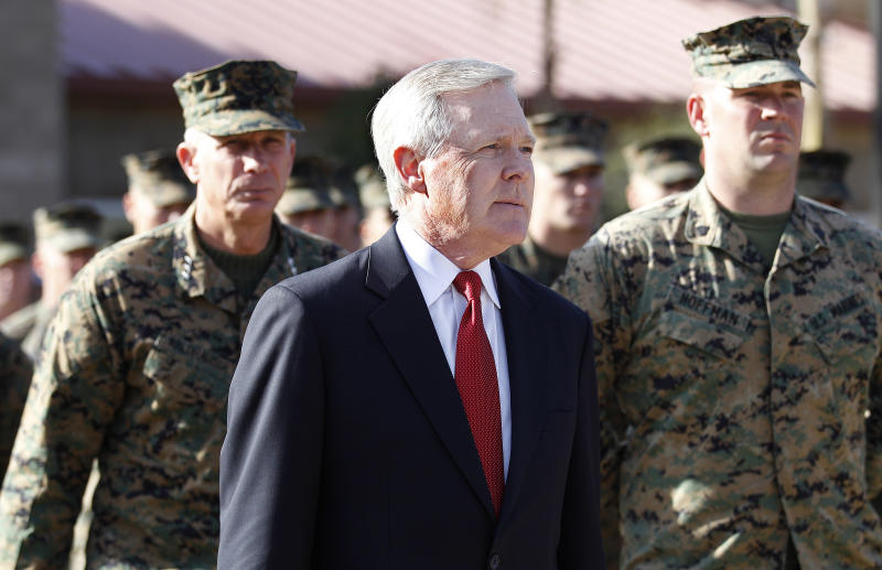 Secretary of the Navy Ray Mabus, center, is followed by Marine Gen. Thomas Waldhauser, left, Tuesday, Jan. 17, 2012 in Cam Pendleton, Calif.  as they arrive for a ceremony in which Mabus presented the Navy Cross posthumously to the parents of  Marine Lance Cpl. Donald Hogan, who was killed in action in Afghanistan in 2009. (AP Photo/Lenny Ignelzi)