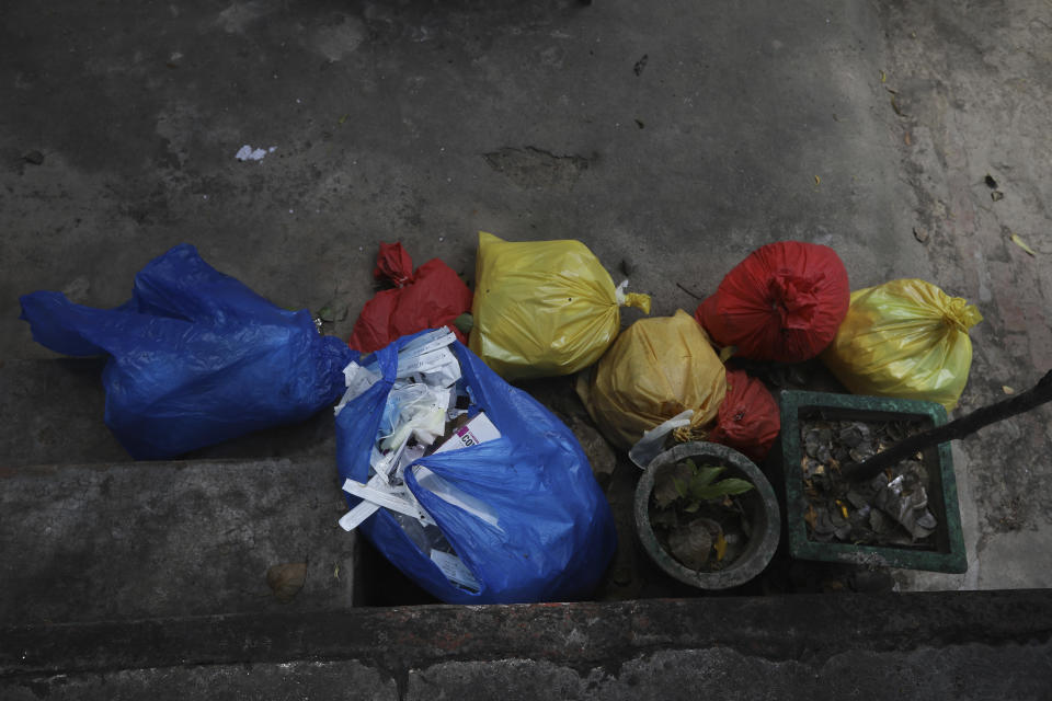 Garbage material of COVID-19 tests are kept aside for disposal in New Delhi, India, Tuesday, Sept. 1, 2020. India has now reported more than 75,000 infections for five straight days, one of the highest in the world, just as the government began easing restrictions to help the battered economy. (AP Photo/Manish Swarup)