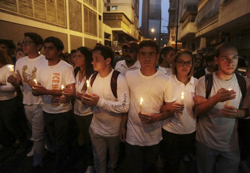 University students hold a candlelight vigil for their late classmate Juan Pablo Pernalete in Caracas, Venezuela, Saturday, April 29, 2017. Students commemorated Pernalete who was killed this week by security forces during an anti-government protest. (AP Photo/Fernando Llano)