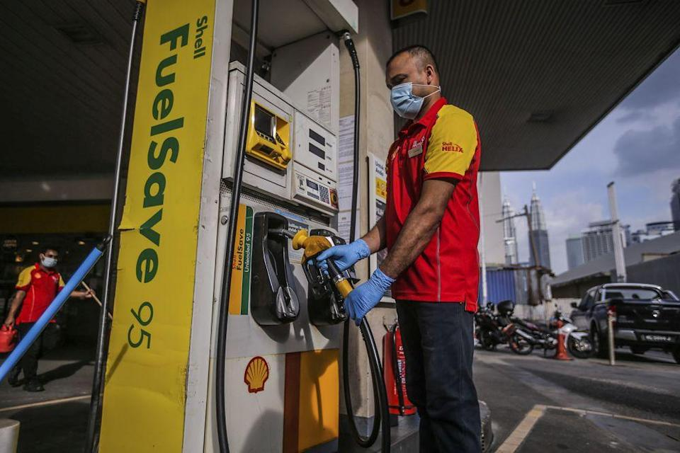 A petrol station attendant is seen in Chow Kit, Kuala Lumpur November 3, 2020. — Picture by Hari Anggara