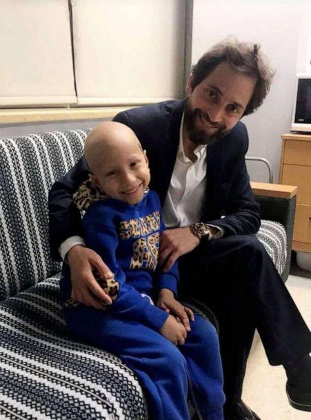PHOTO: Nehad Dabbas sits with Abd el Karim, a child cancer patient, in 2019. (Nehad Dabbas)