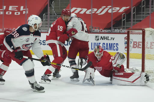 Detroit Red Wings goaltender Thomas Greiss (29) stops a Columbus Blue Jackets center Boone Jenner (38) shot in the first period of an NHL hockey game Monday, Jan. 18, 2021, in Detroit. (AP Photo/Paul Sancya)