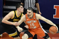 Illinois forward Giorgi Bezhanishvili (15) pushes Iowa's center Luka Garza in the first half of an NCAA college basketball game Friday, Jan. 29, 2021, in Champaign, Ill. (AP Photo/Holly Hart)