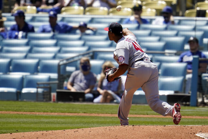 Washington Nationals starting pitcher Joe Ross throws to the Los Angeles Dodgers during the first inning of a baseball game, Friday, April 9, 2021, in Los Angeles. (AP Photo/Marcio Jose Sanchez)