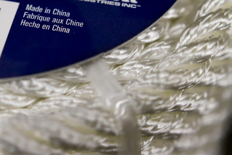 FILE - In this May 9, 2019, file photo synthetic rope, with labeling indicating it was made in China, is displayed in a store in Cranberry Township, Pa. Faced with the prospect of a forever war with America's trading partners, numerous businesses say they're delaying investment decisions and reviewing their business relationships until they have a clearer view of how President Donald Trump's trade wars might end. (AP Photo/Keith Srakocic, File)