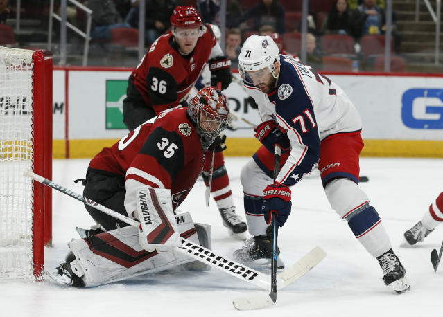 Arizona Coyotes goaltender Darcy Kuemper (35) makes a save against Columbus Blue Jackets left wing Nick Foligno (71) in the first period during an NHL hockey game, Thursday, Feb. 7, 2019, in Glendale, Ariz. (AP Photo/Rick Scuteri)