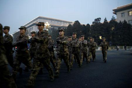 Soldiers patrol outside the Great Hall of the People in Beijing