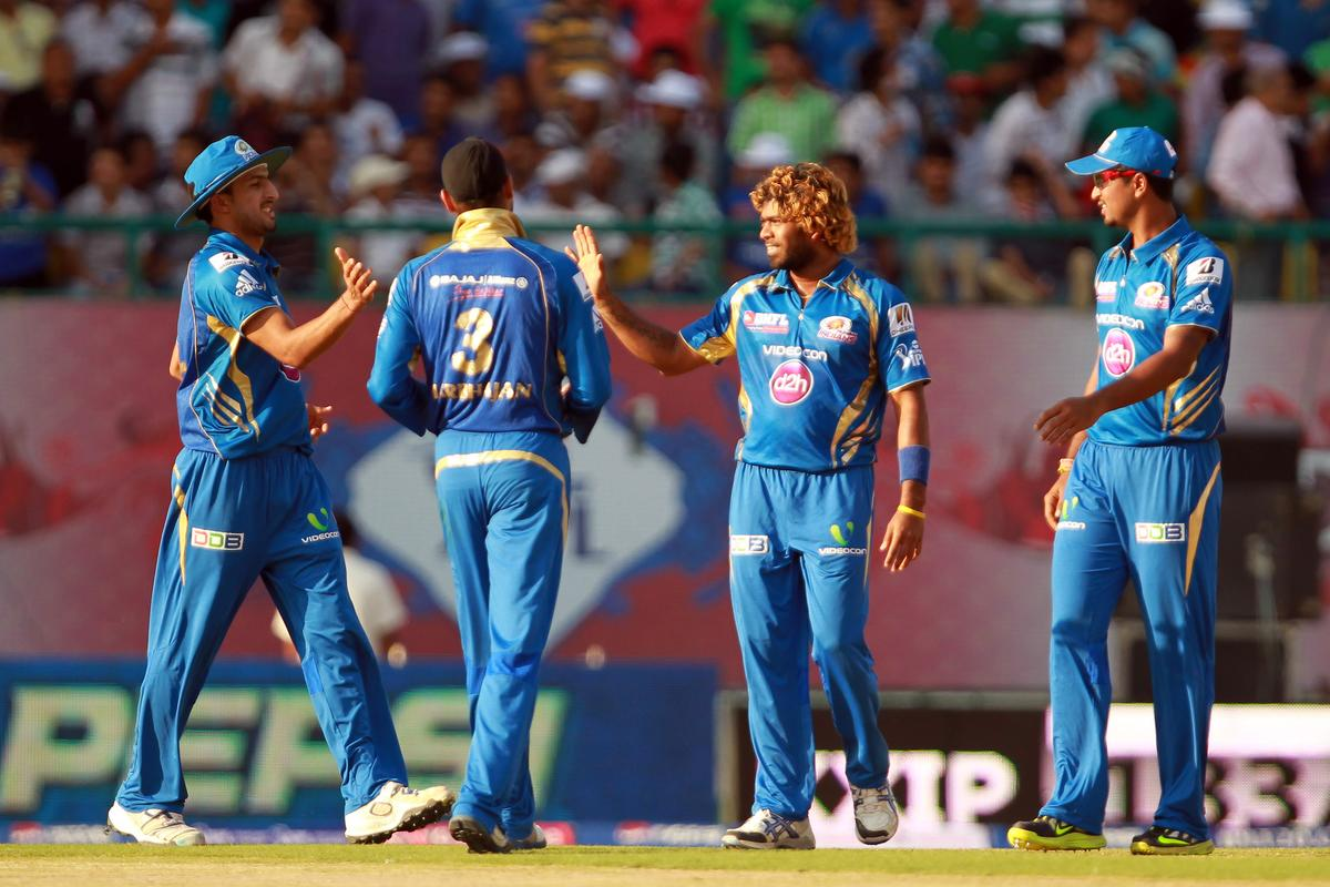 Lasith Malinga is congratulated by his teammates after taking the wicket of Praveen Kumar during match 69 of the Pepsi Indian Premier League between The Kings XI Punjab and the Mumbai Indians held at the HPCA Stadium in Dharamsala, Himachal Pradesh, India on the on the 18th May 2013. (BCCI)