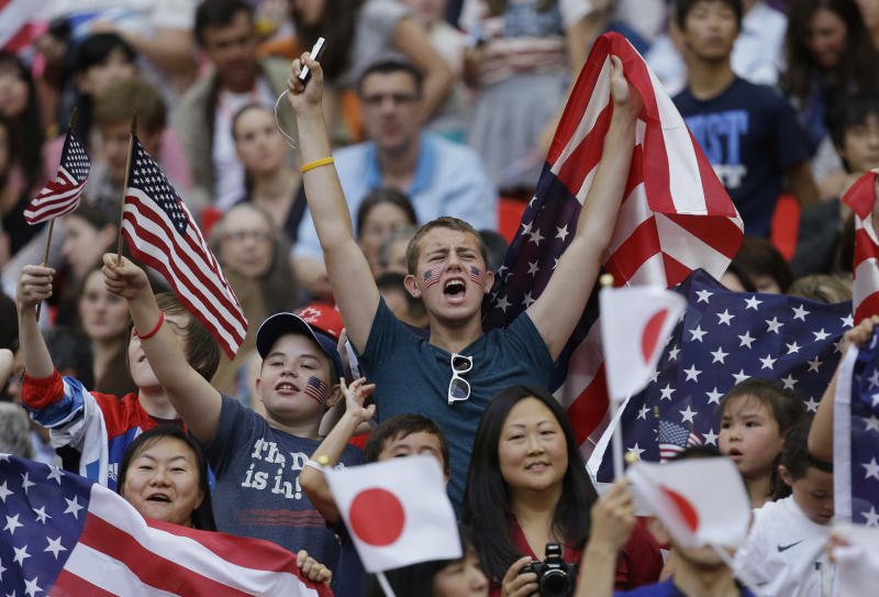 Fans cheer before the start of the women's soccer gold medal match between the United States and Japan at the 2012 Summer Olympics, Thursday, Aug. 9, 2012, in London. (AP Photo/Julie Jacobson)