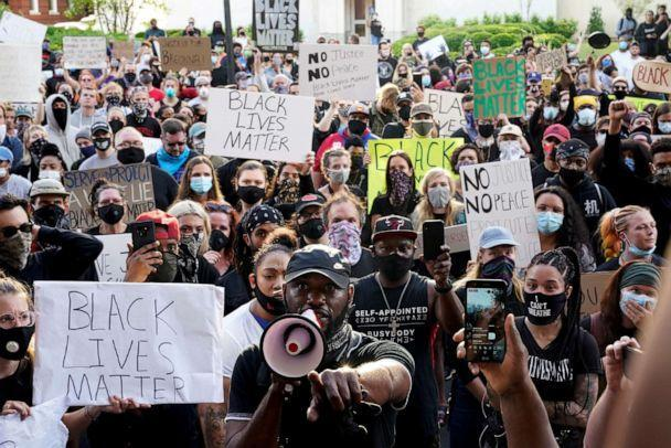PHOTO: People gather in front of Louisville City Hall during a protest against the deaths of Breonna Taylor by Louisville police and George Floyd by Minneapolis police, in Louisville, Ky., May 29, 2020. (Bryan Woolston/Reuters, FILE)